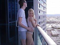 Seducing a blonde on a balcony