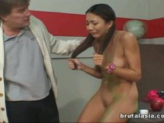 Charming oriental chick getting her pussy fingerfucked on the table